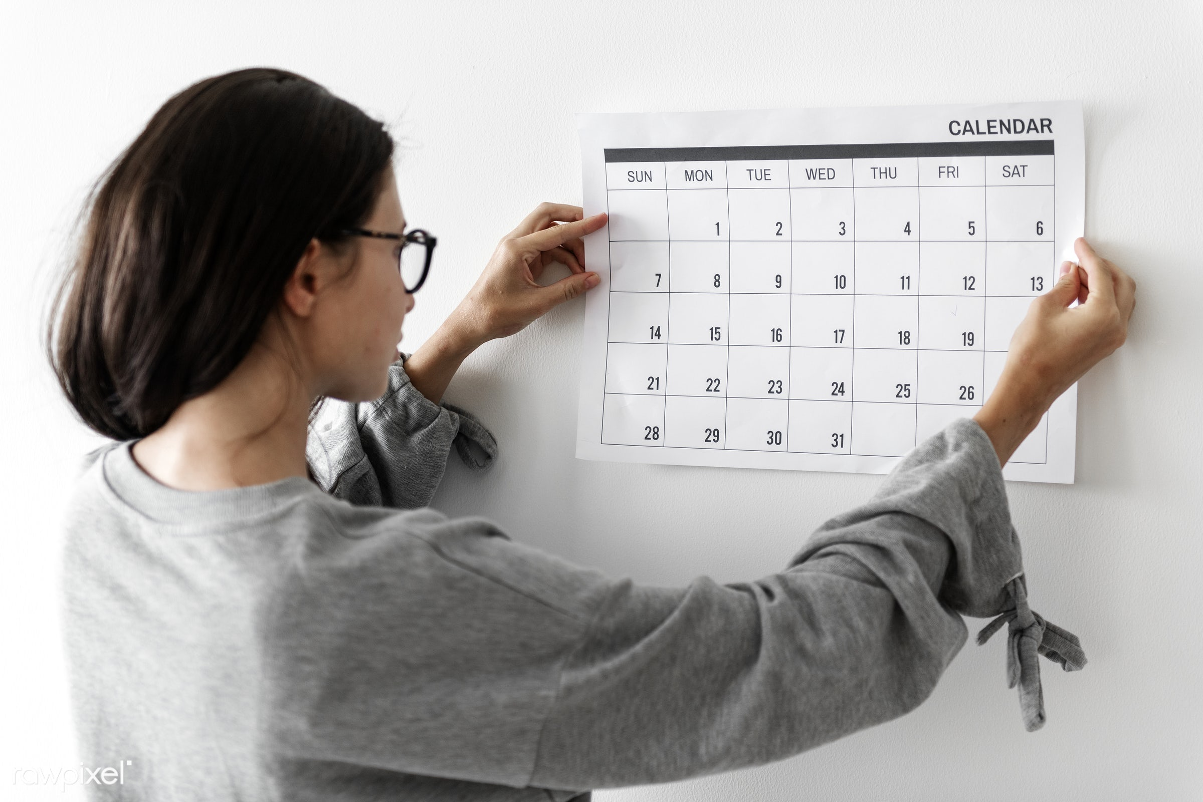 Woman checking the calendar - calendar, schedule, plan, woman, office, planning, working, note, work, planner, workplace,...