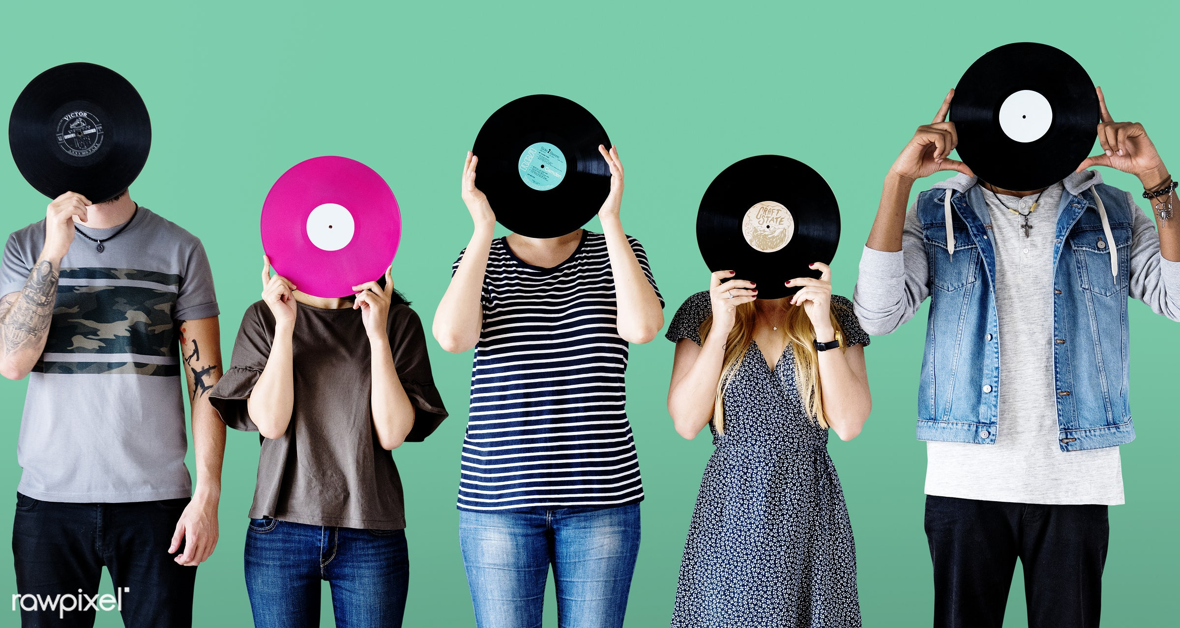 Group of young adults with vinyl disc - american, audio, band, casual, caucasian, cheerful, enjoying, entertainment,...