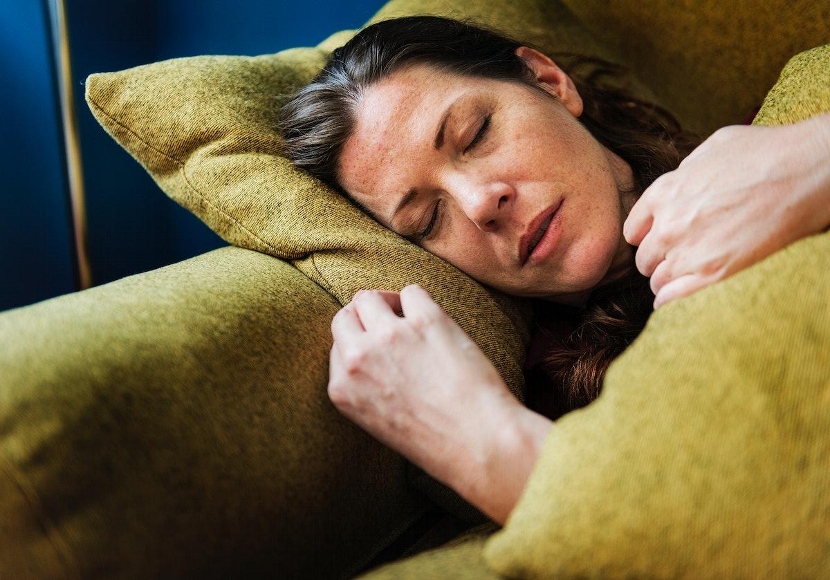Woman sick on the sofa