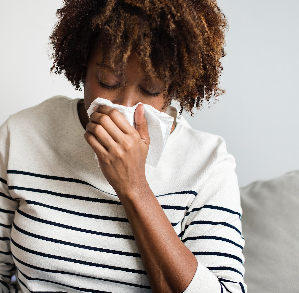 Woman sick at home on the couch