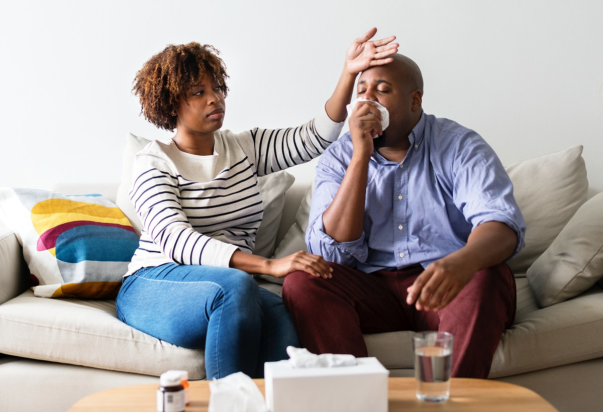 Couple sick at home on the sofa