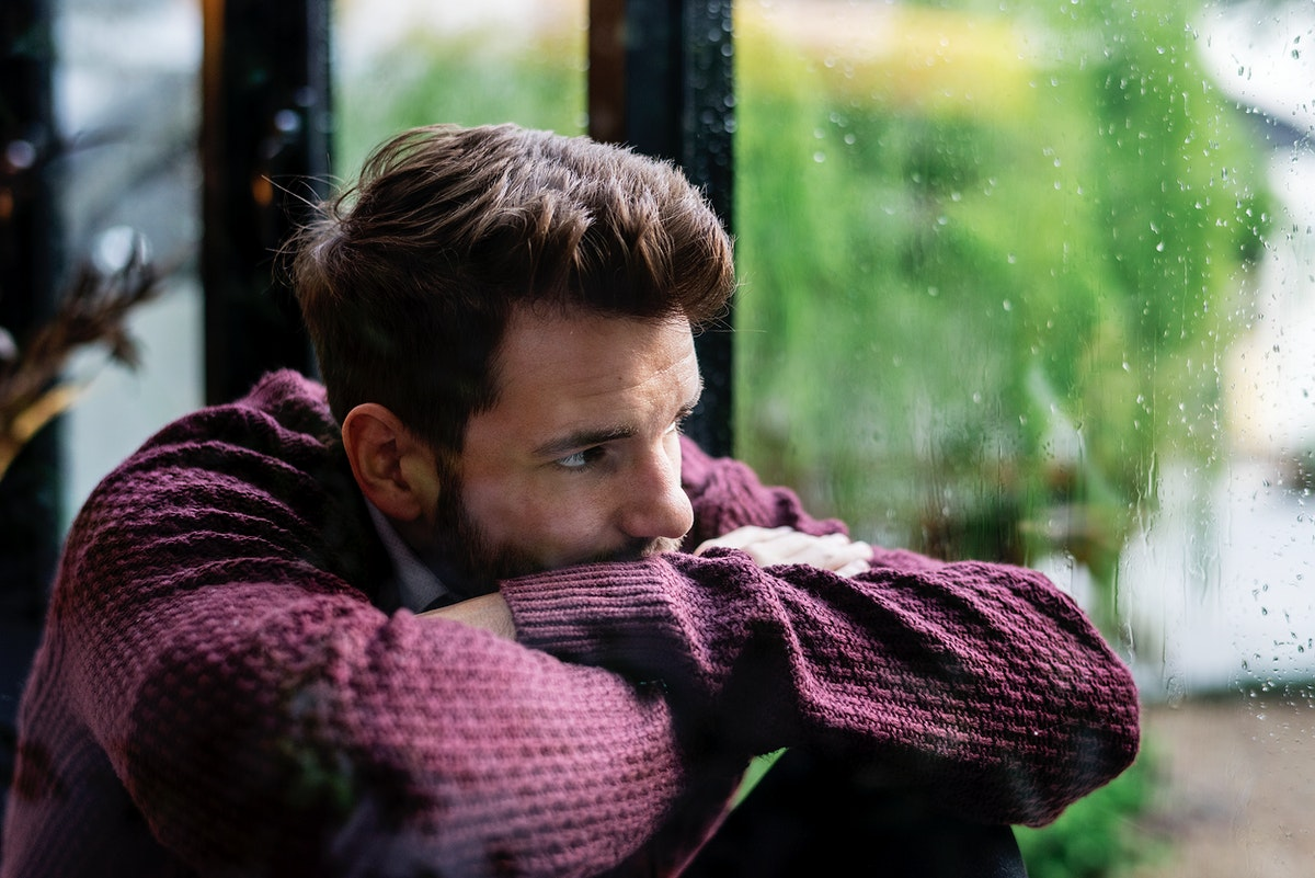 Thoughtful man looking out the window