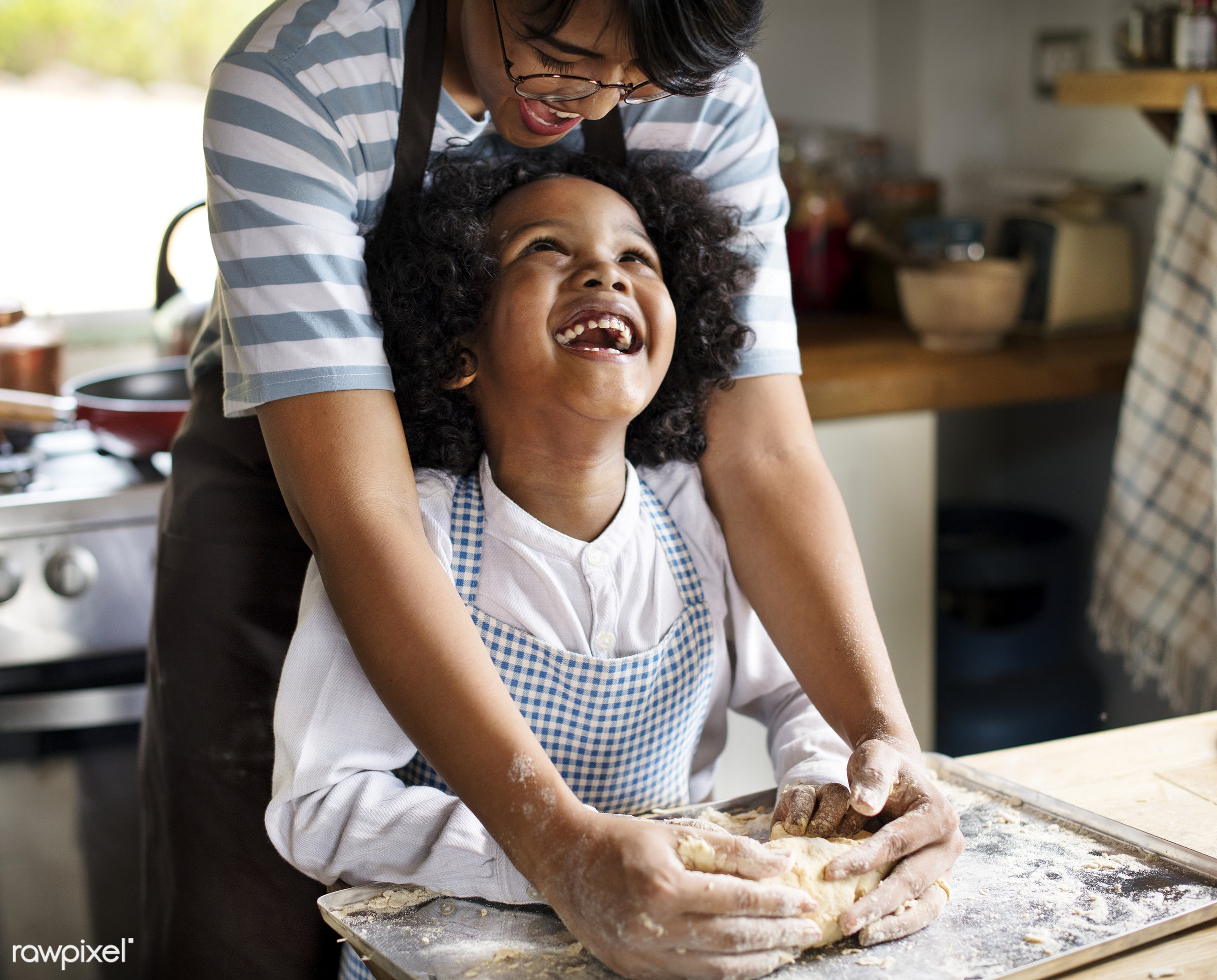 Mother and son kneading dough in the kitchen - activity, african american, african descent, afro, apron, asian, bake, baking...