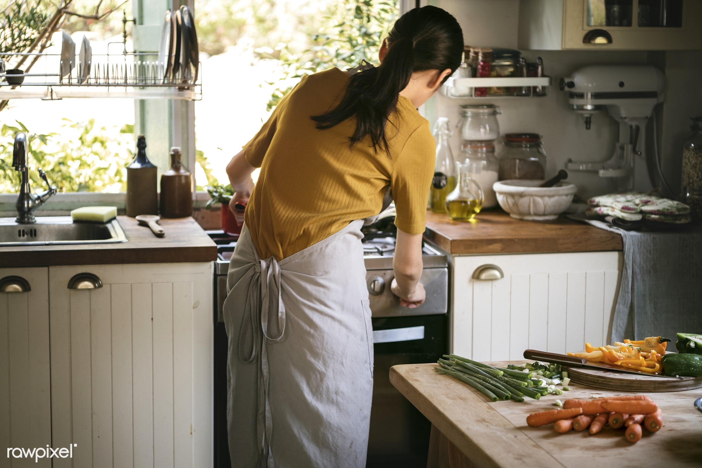 Asian woman cooking in her kitchen - asian, asparagus, breakfast, carrots, chef, cook, cooking, cucumber, cuisine, cut,...