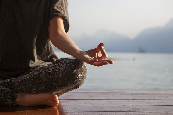 Woman practicing yoga as a self care activity