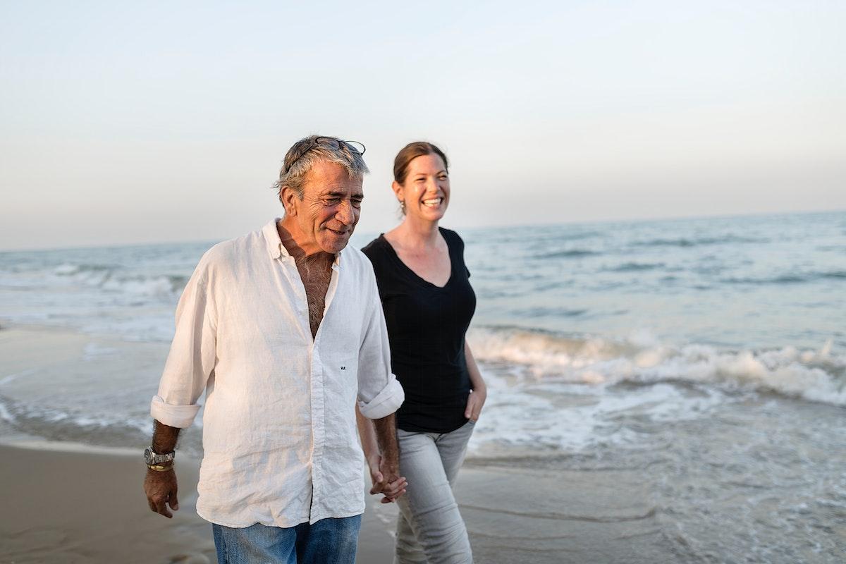 Couple walking by the seashore