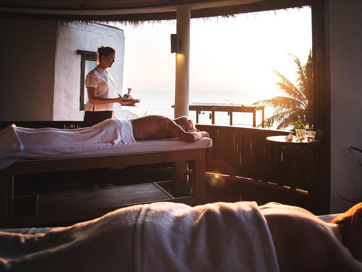 Massage therapist massaging at a spa