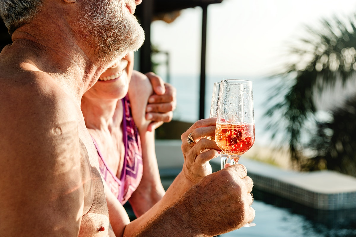 Mature couple celebrating with prosecco