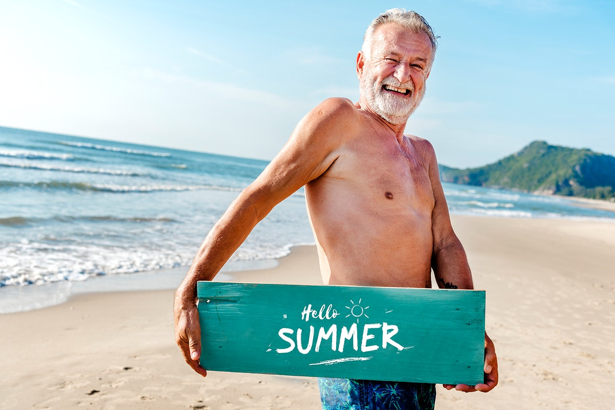 Senior man holding a plank with Hello Summer