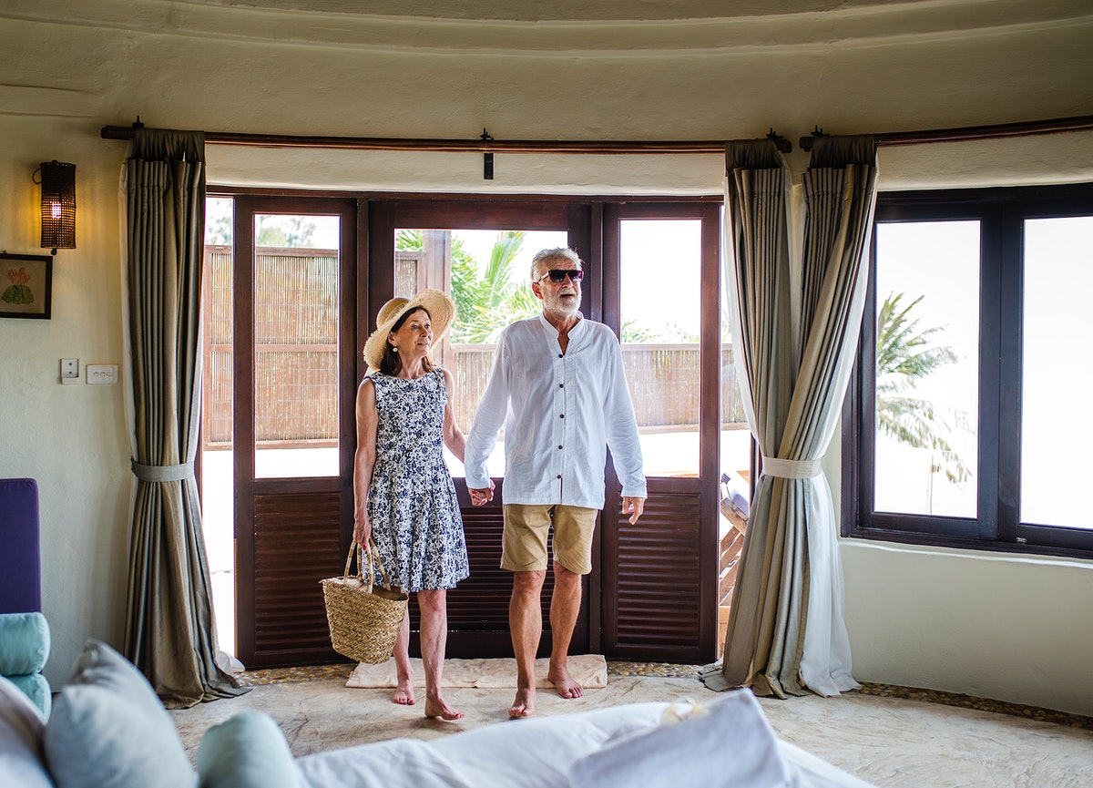 Senior couple checking in to a resort