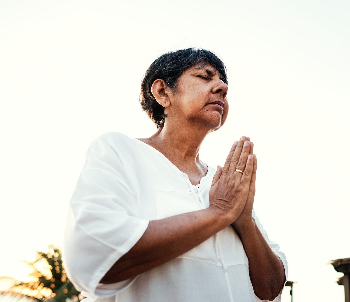Senior adult practicing yoga outdoors