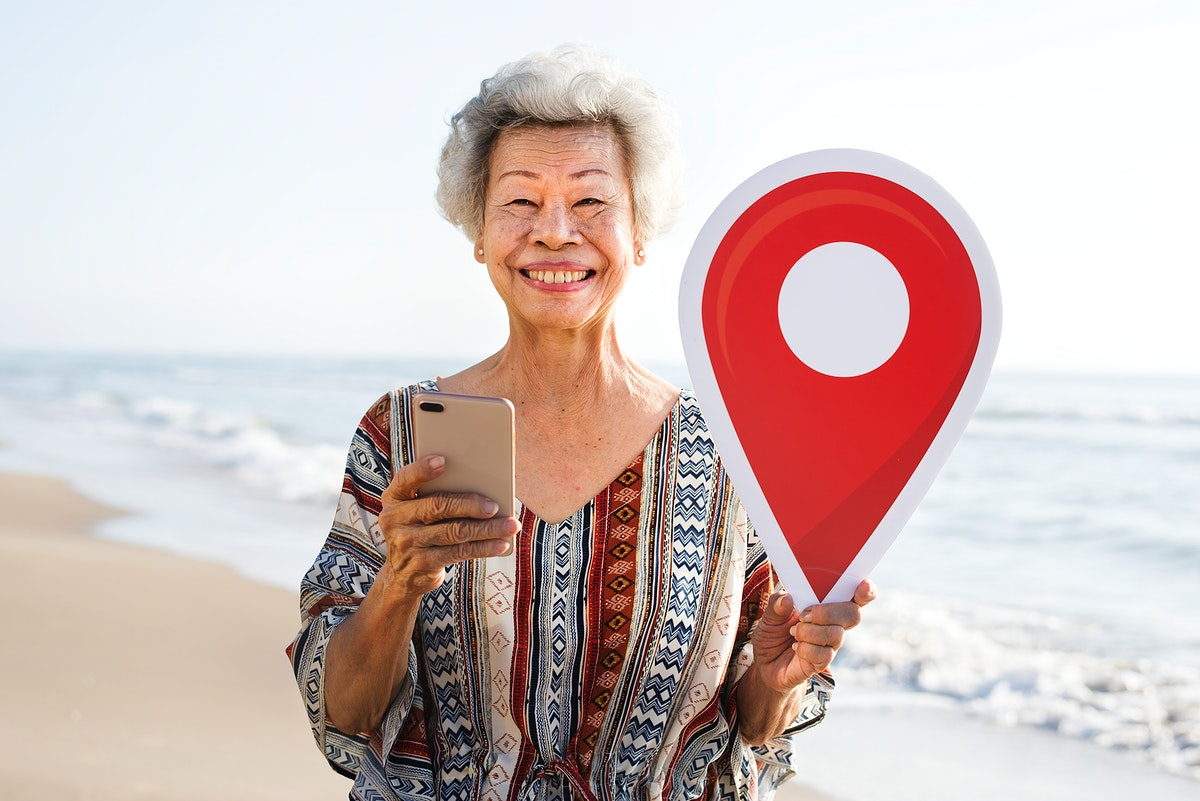 Senior Asian woman checking in at the beach