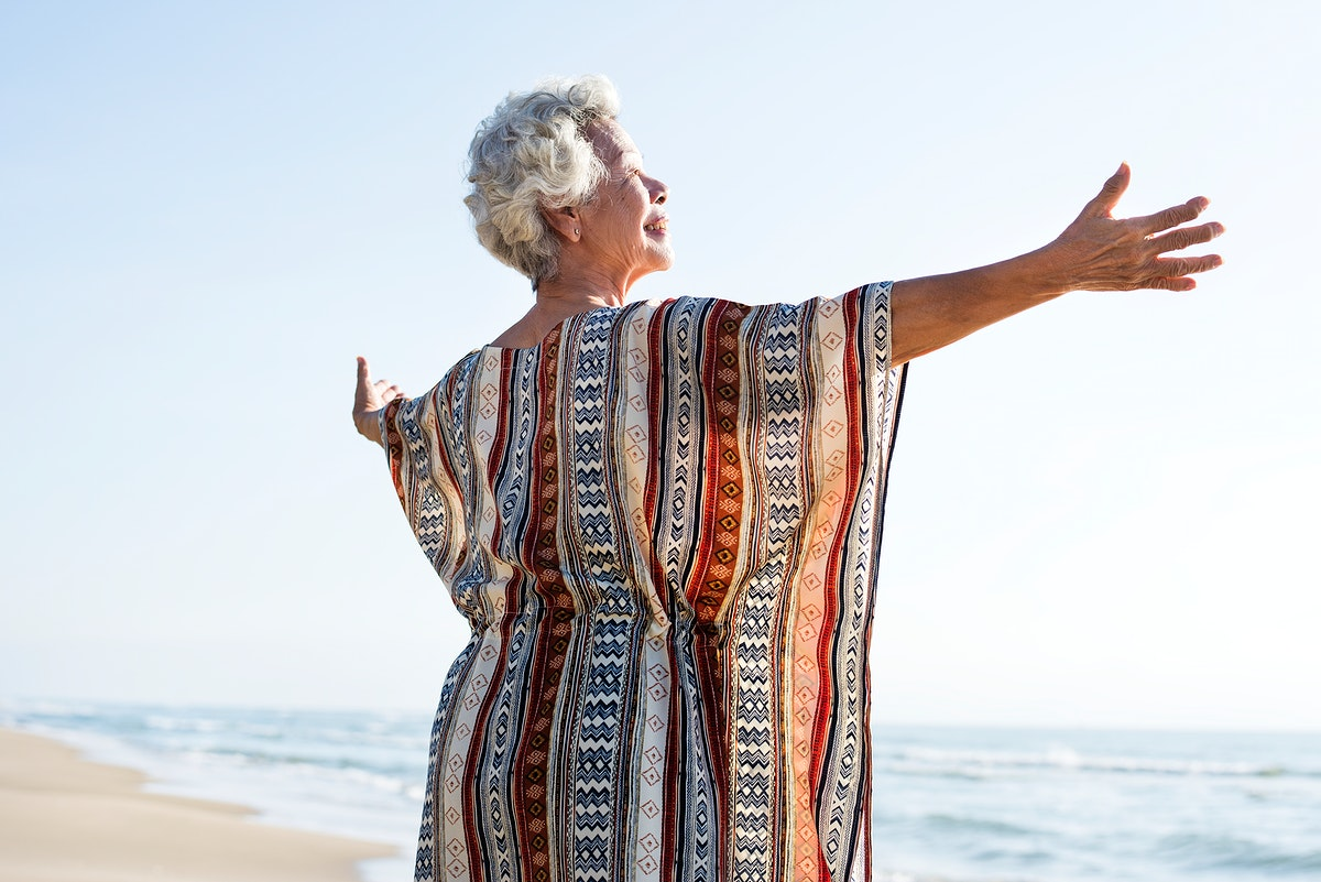 Senior Asian woman at the beach