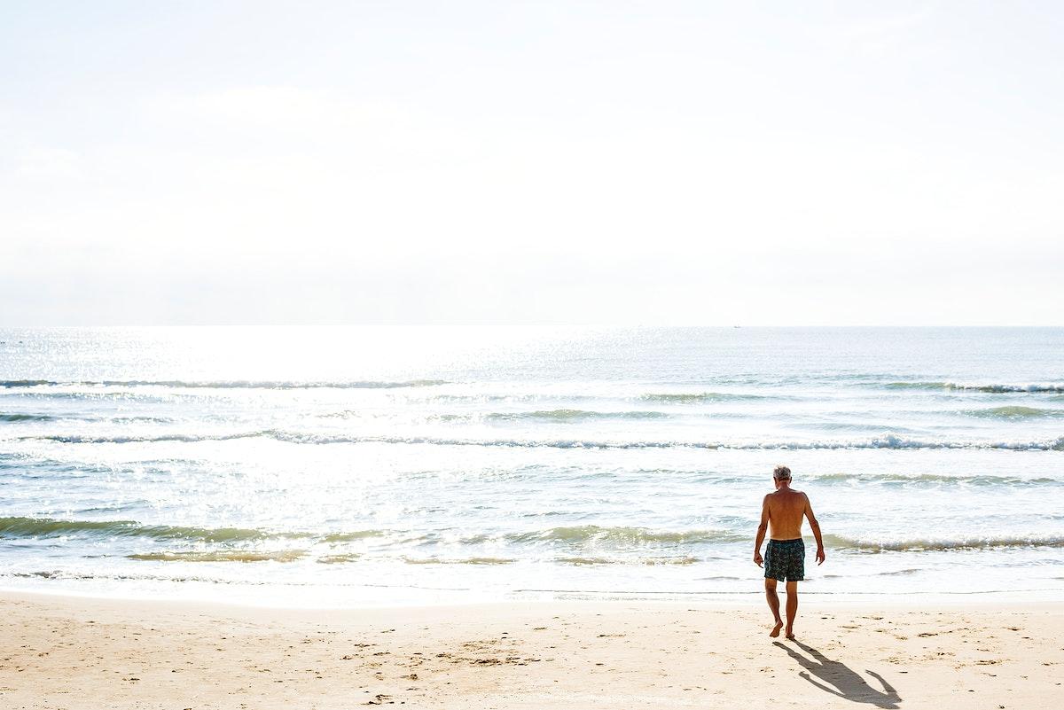 Man walking down the beach