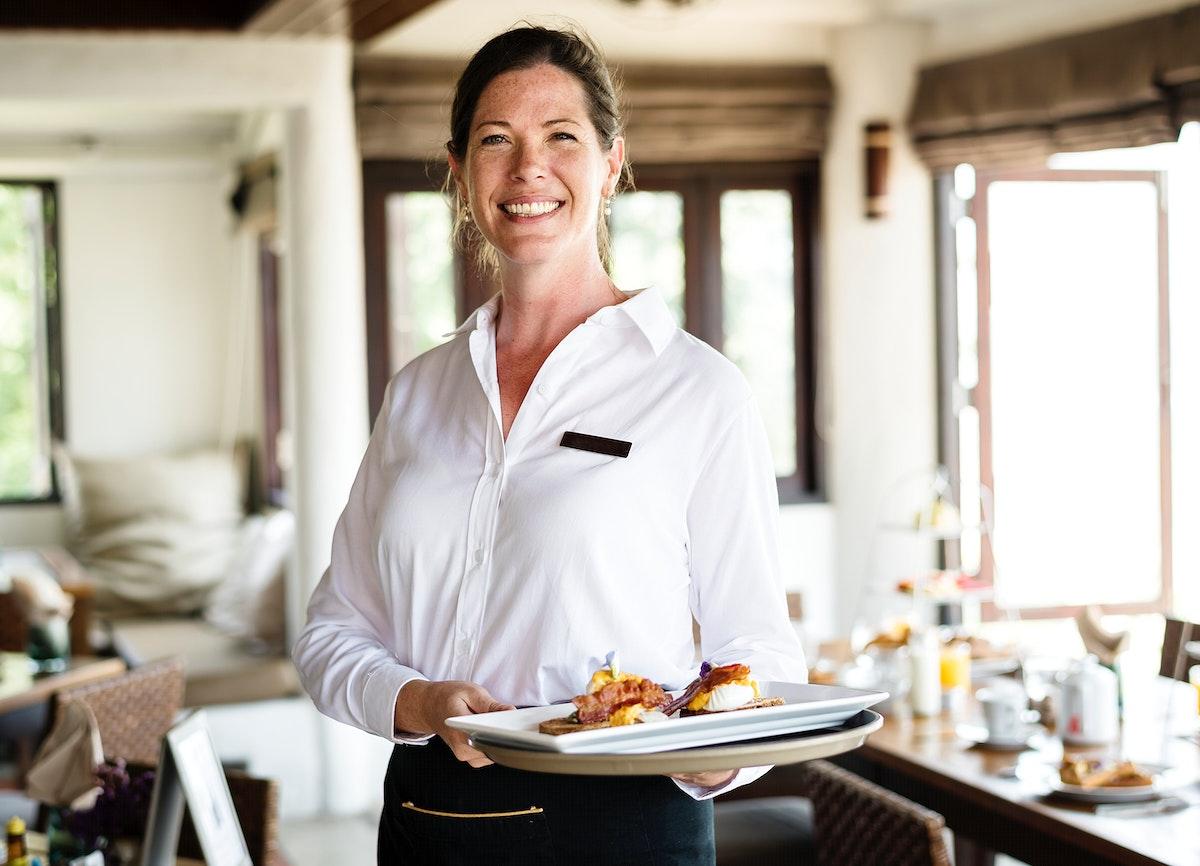 Waitress serving breakfast at a restaurant