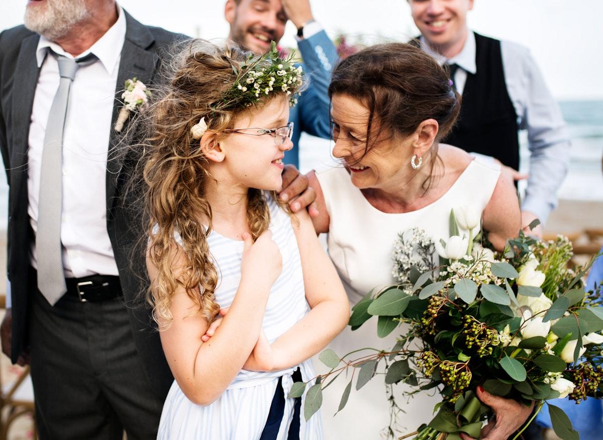 Senior bride with the flower girl
