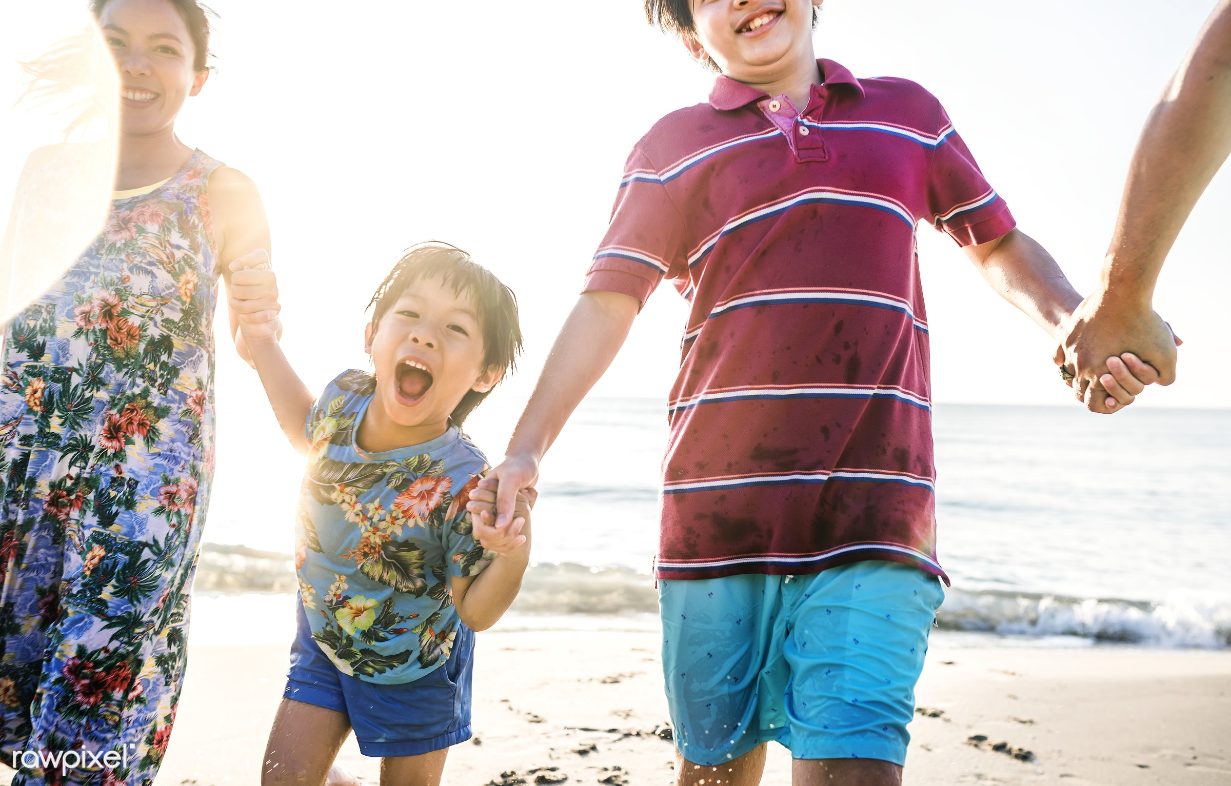 Asian family on vacation - activity, asian, beach, boy, brother, casual, cheerful, child, chinese, coastline, enjoyment,...