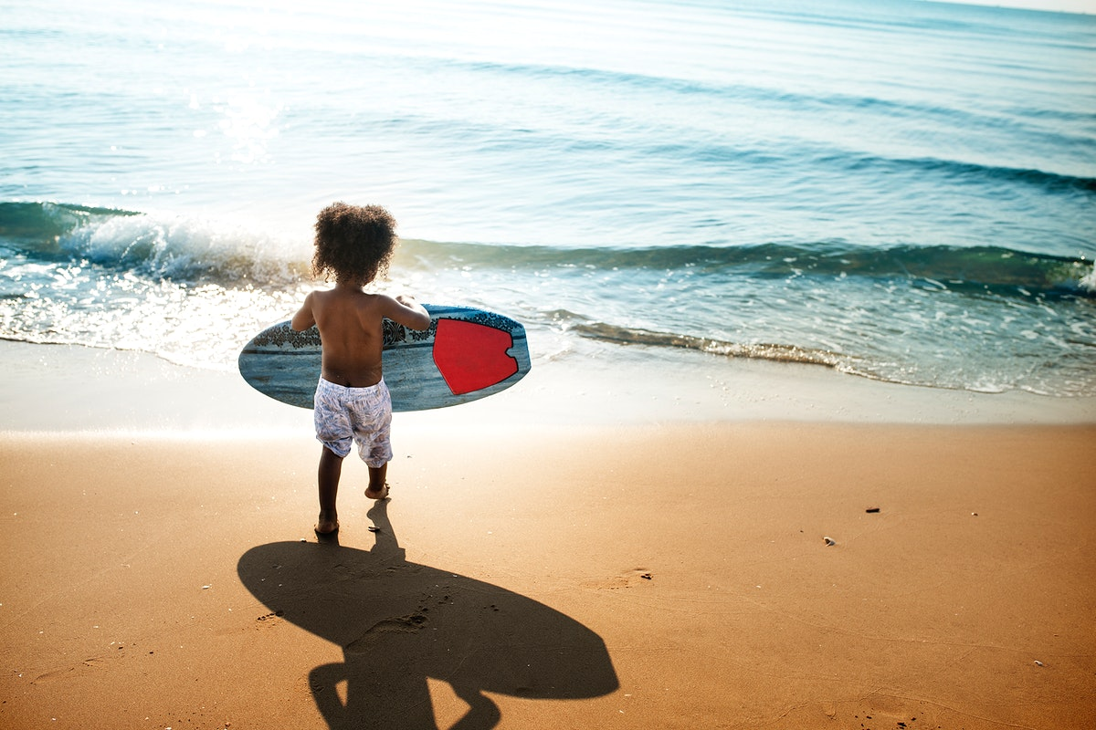 Little kid playing at the beach