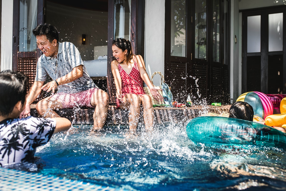 Family playing in a pool