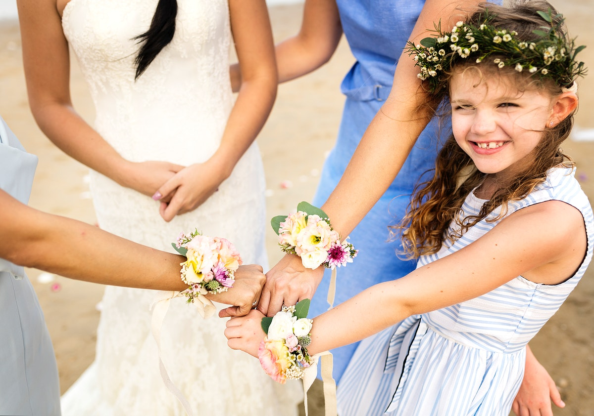 Bridal party showing their flower bracelets