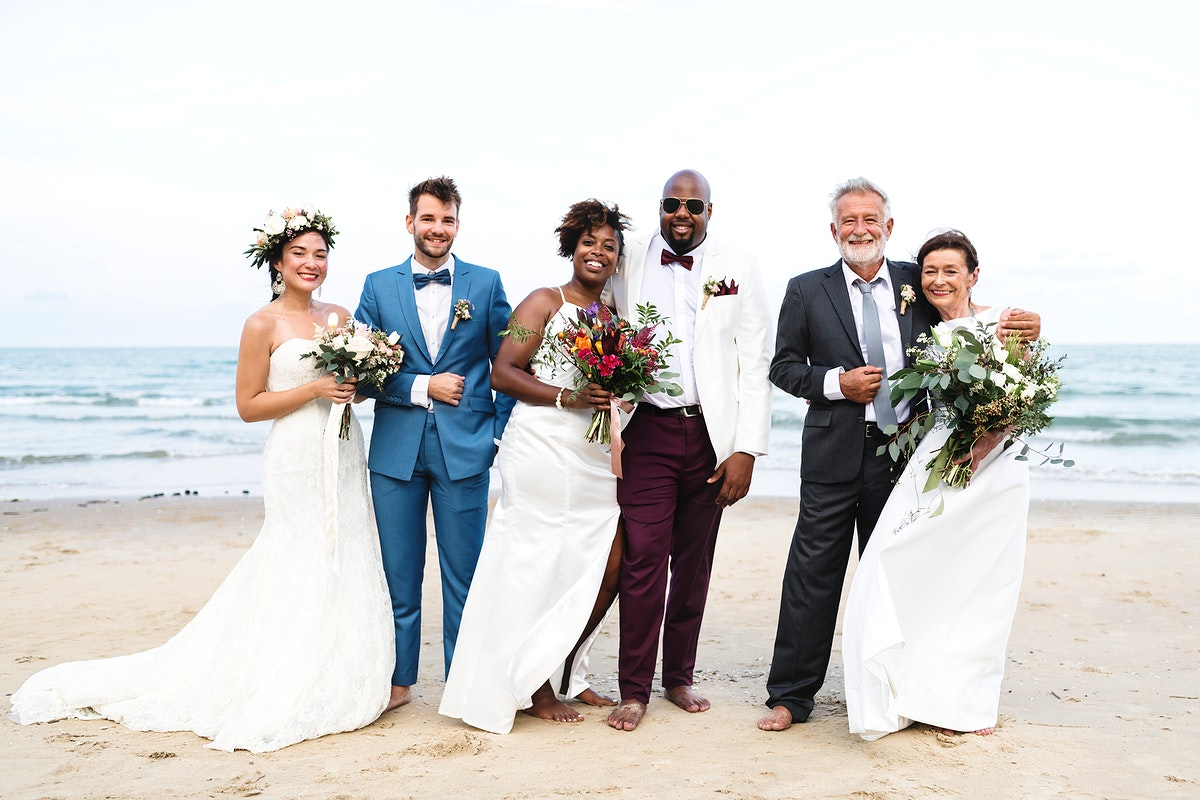 Three newly wed couples on the beach