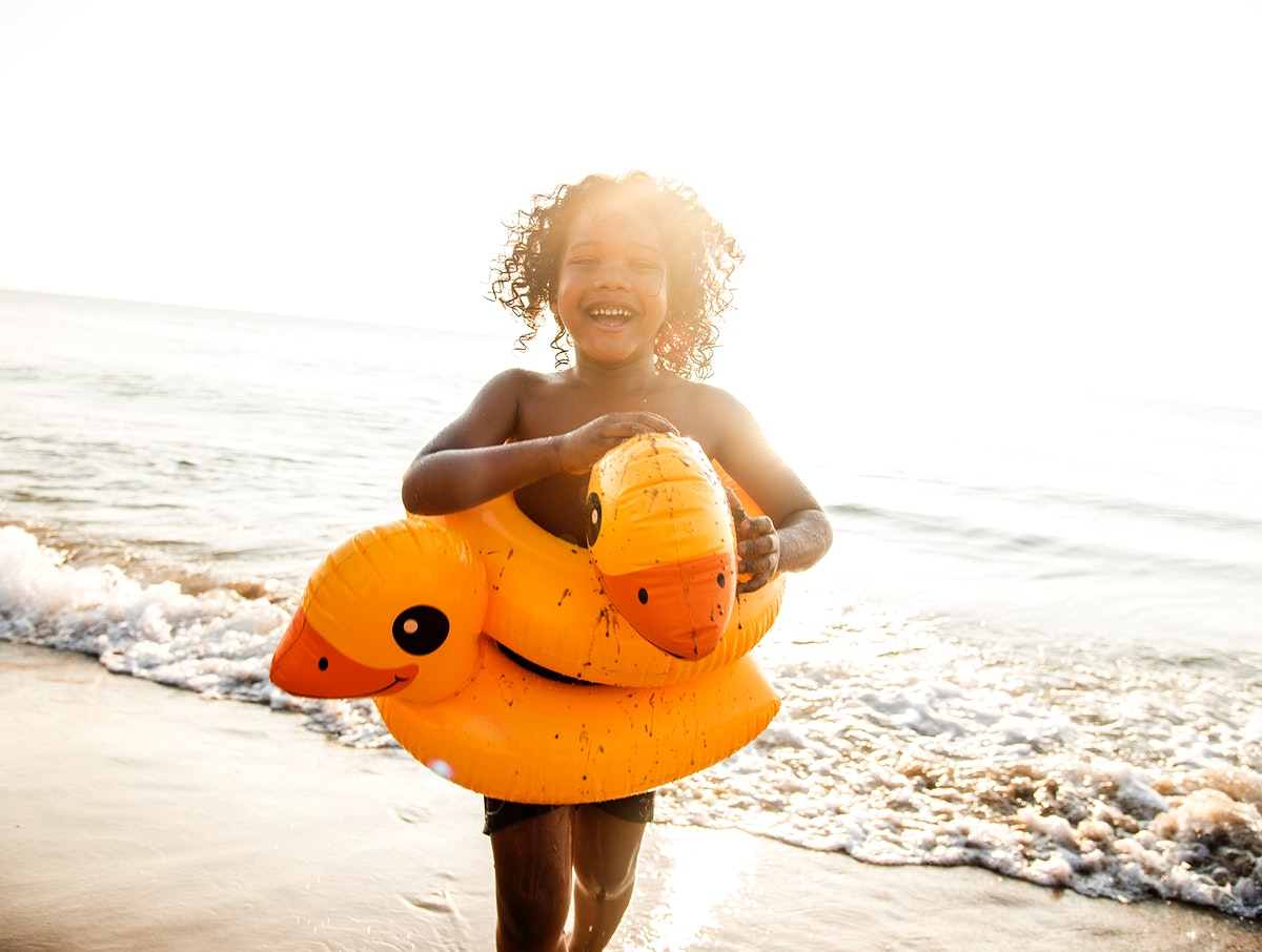 African little boy playing at the beach