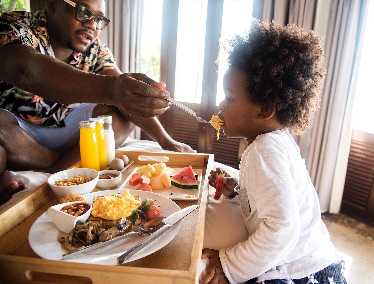 African family having breakfast in bed