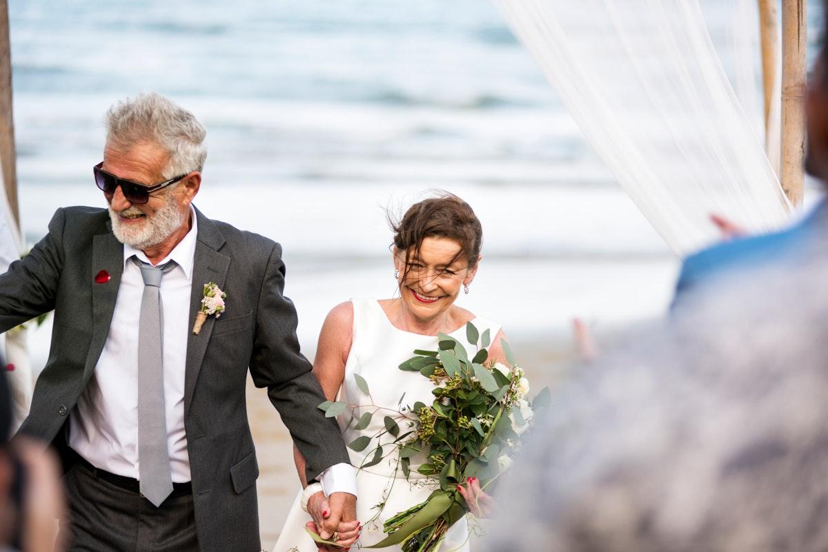 Senior couple at their beach wedding