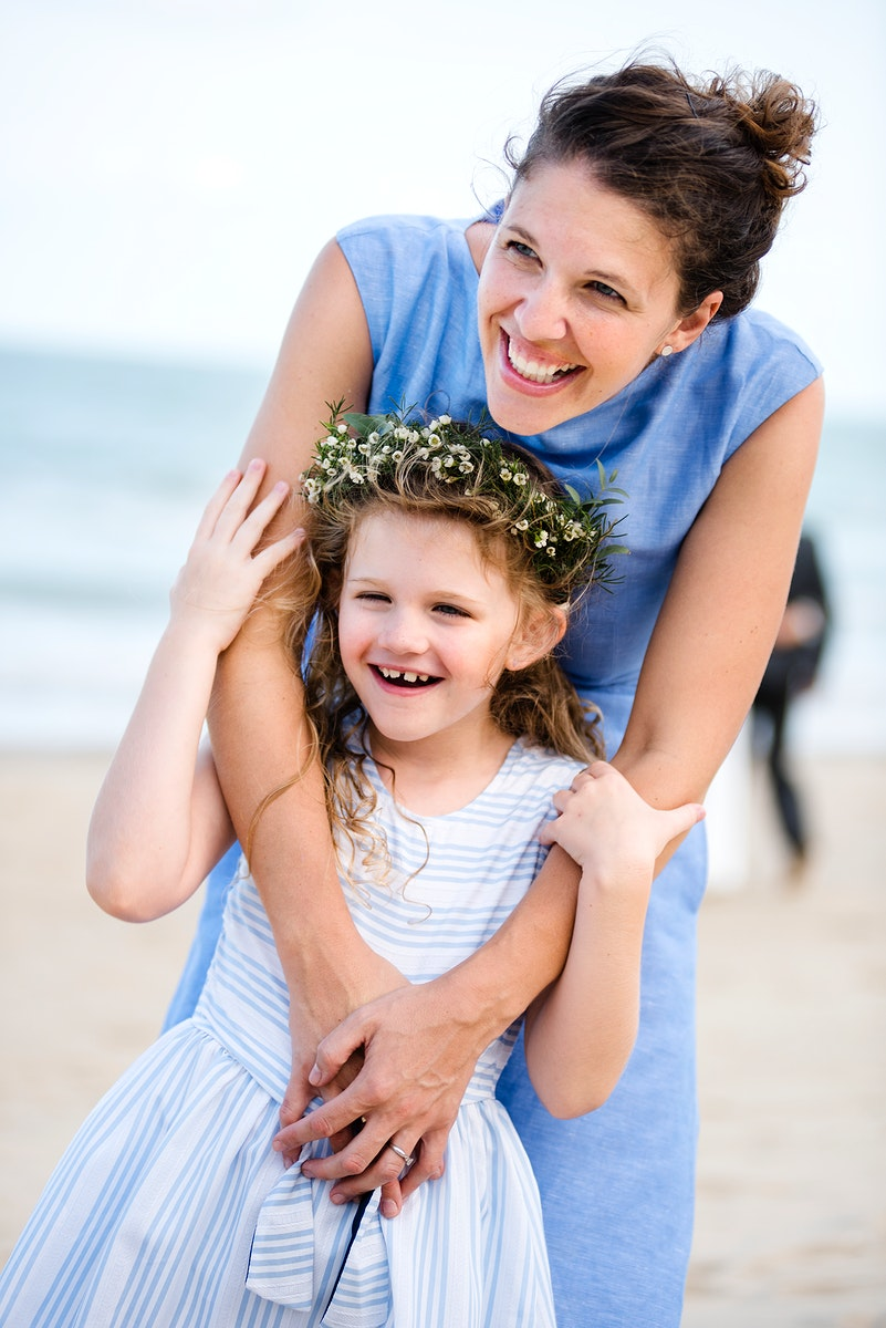Mother and daughter at a beach wedding
