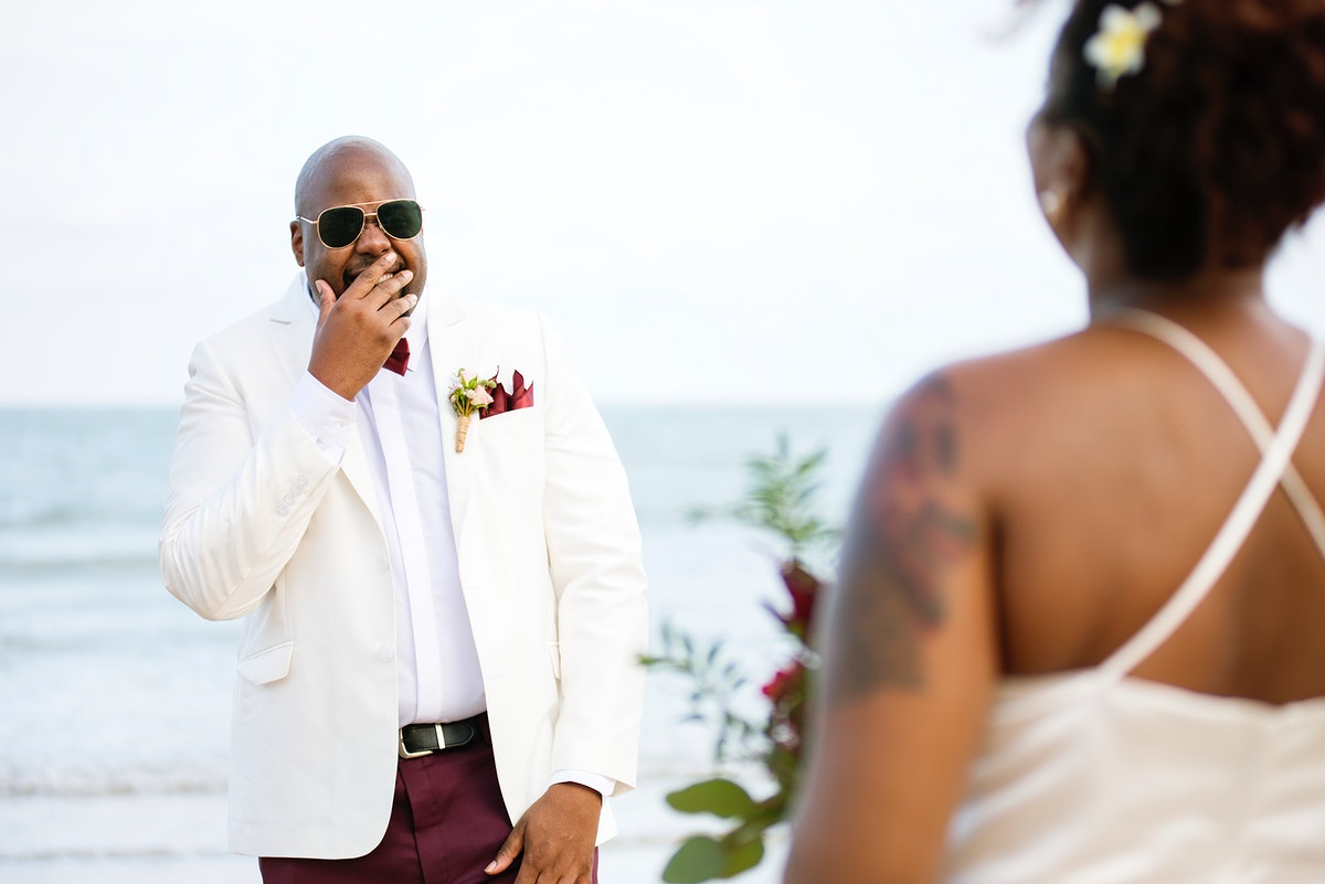 Groom stunned by his bride down the aisle