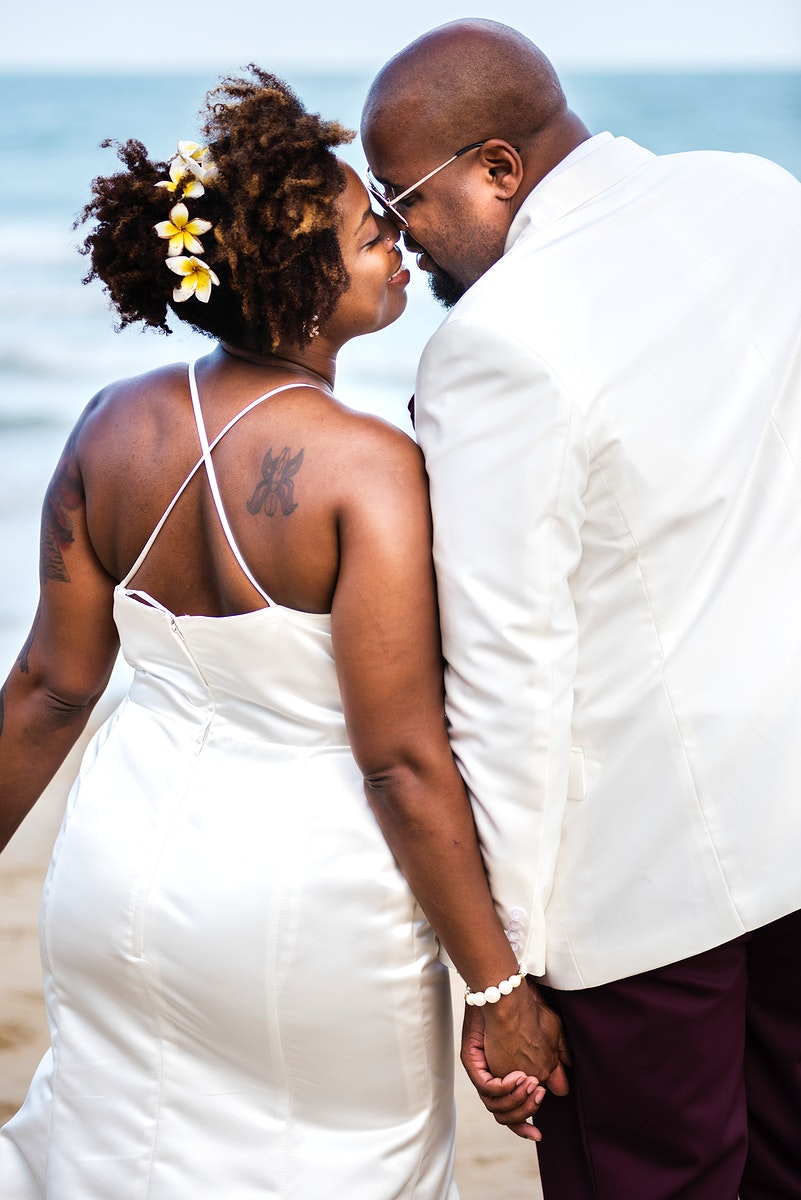 African American couple getting married at the beach