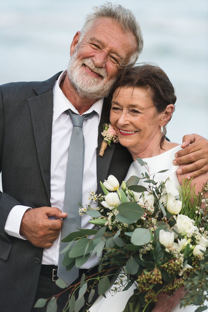 Senior couple getting married at the beach