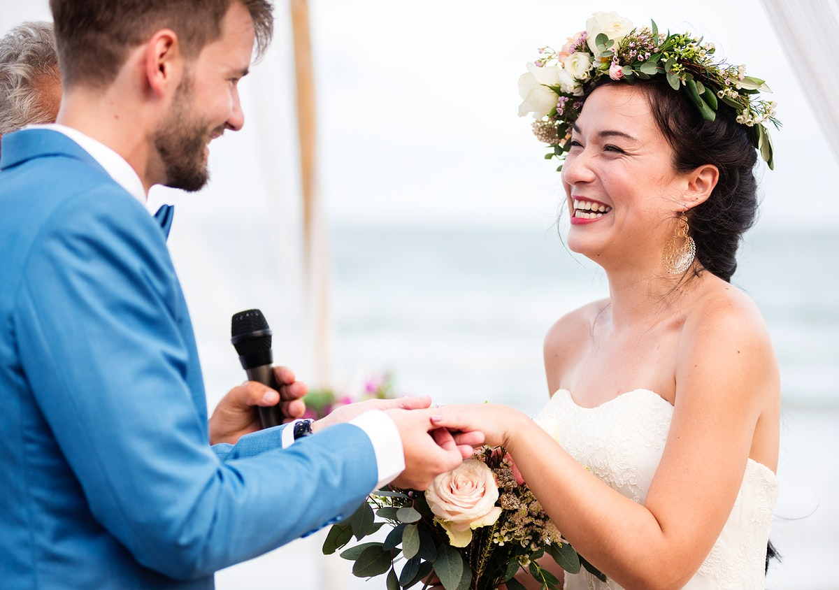 Young couple in a wedding ceremony at the beach
