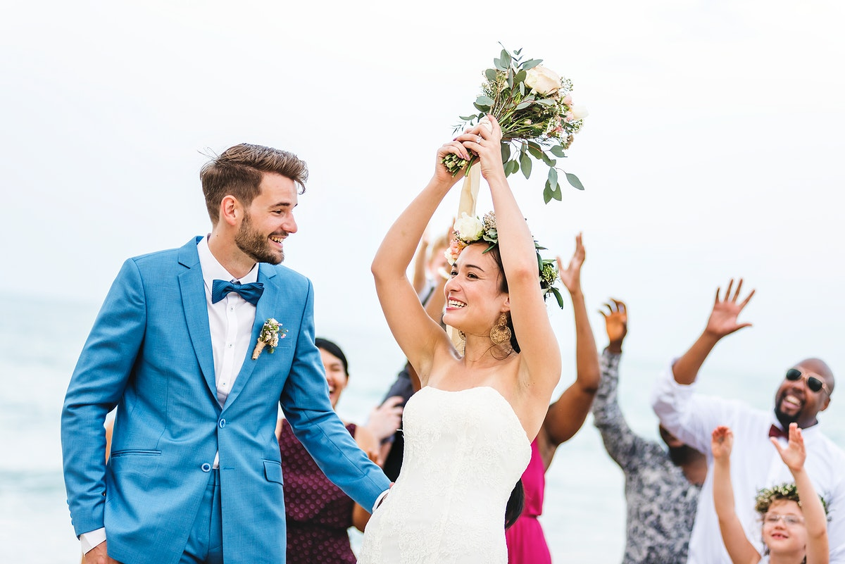 Bride throwing flower bouquet to guests