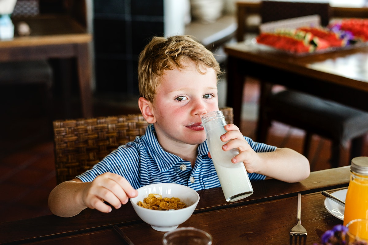 Caucasian kid having breakfast alone