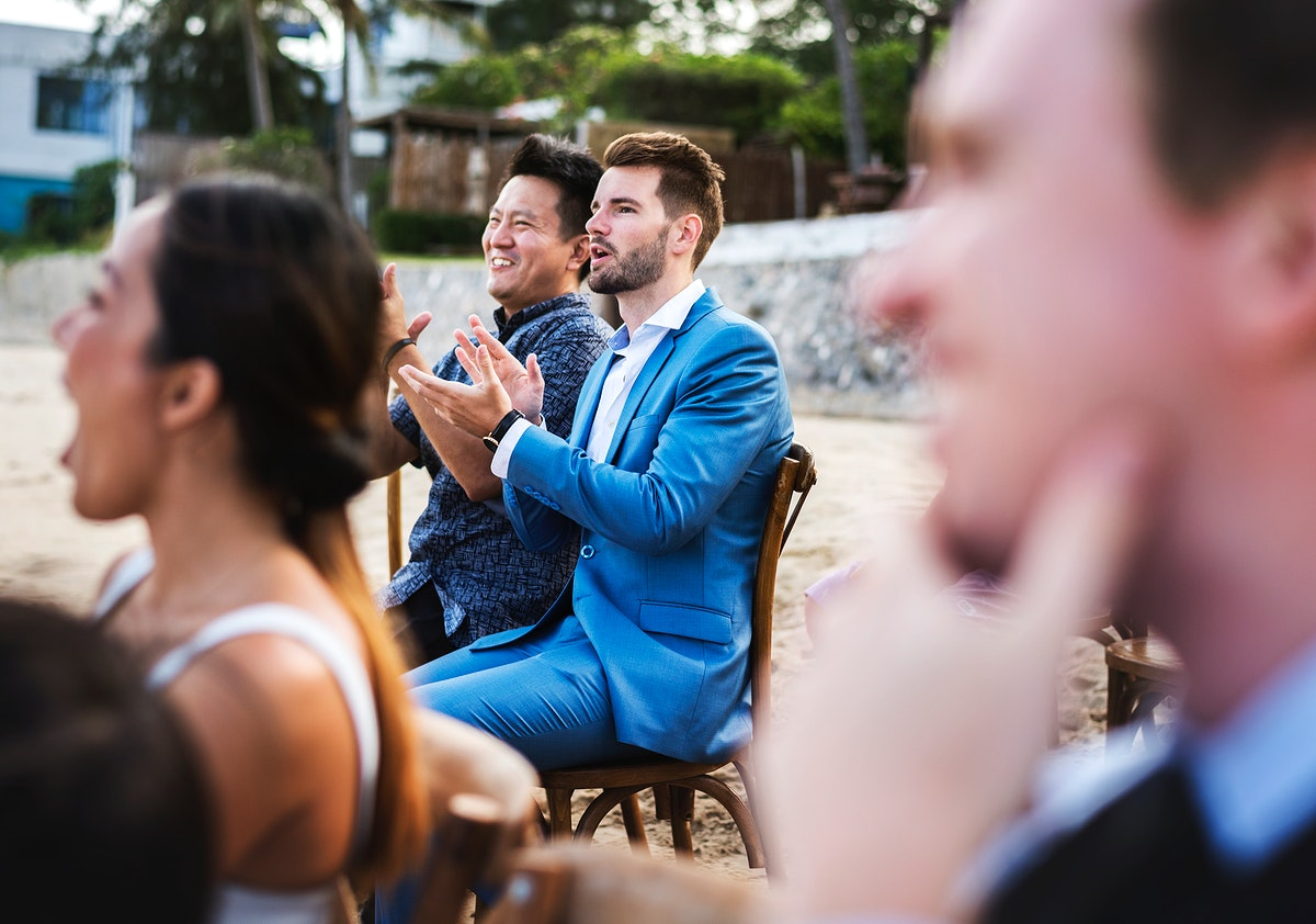 Guests attending a beach wedding ceremony