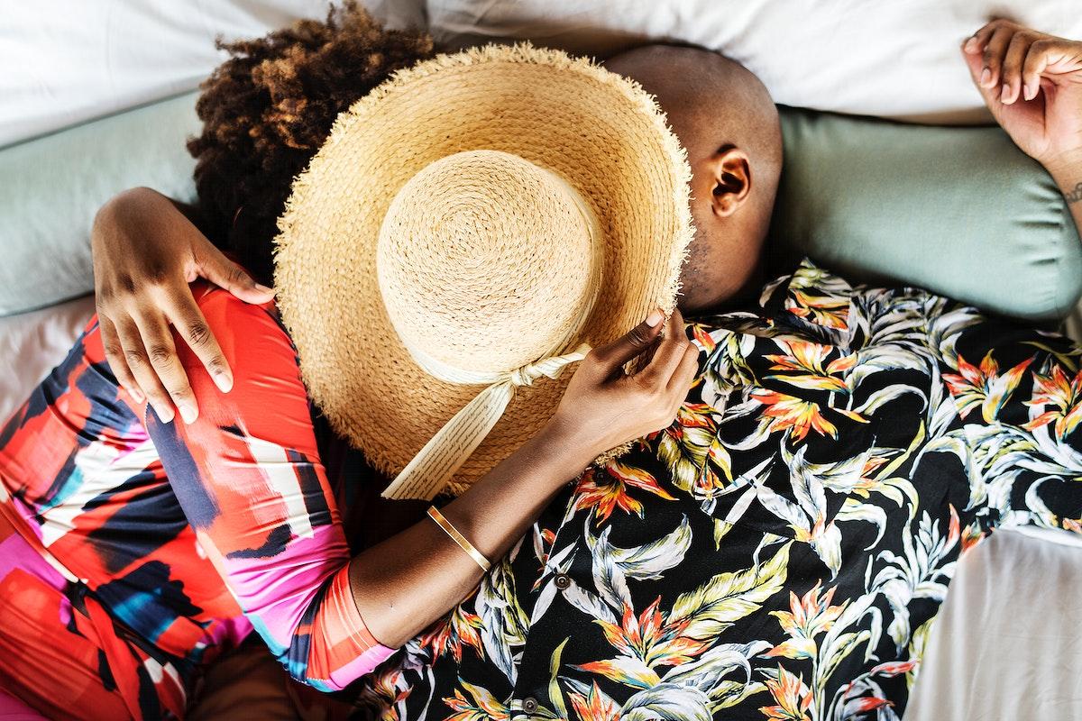 Romantic bohemian couple on bed