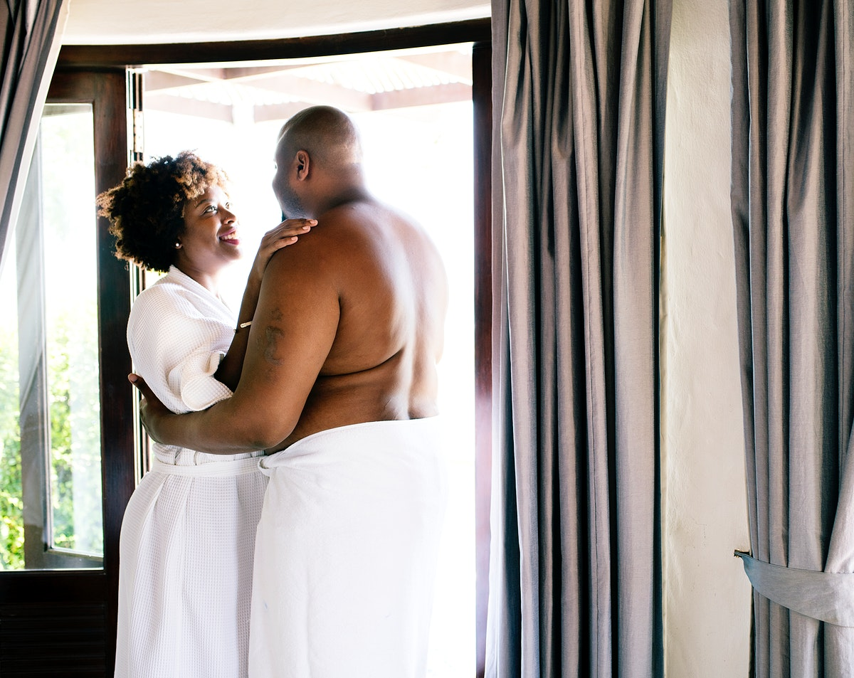 Couple standing together in hotel room