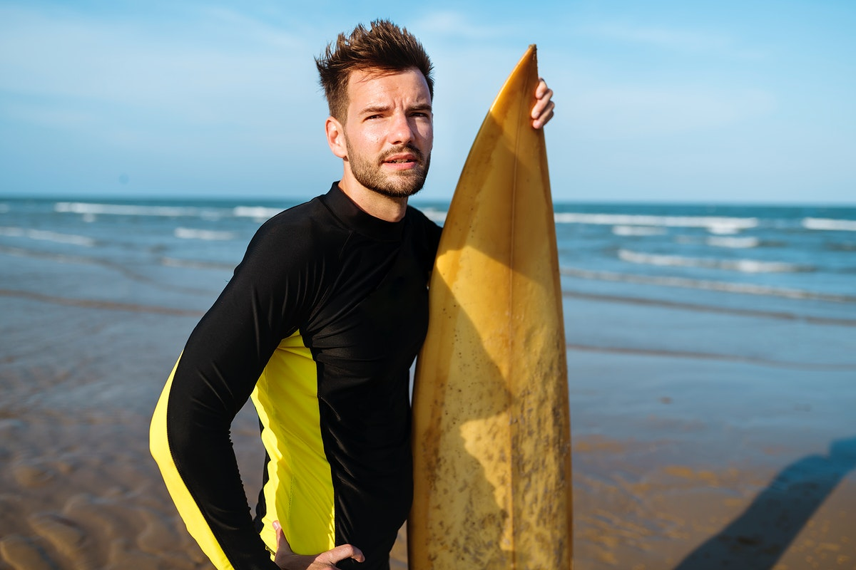 Man with a surfboard at the beach