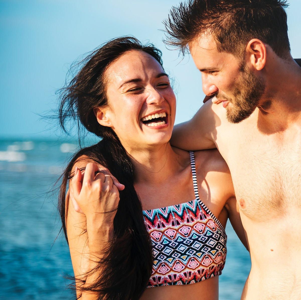 Happy couple having a romantic moment at the beach
