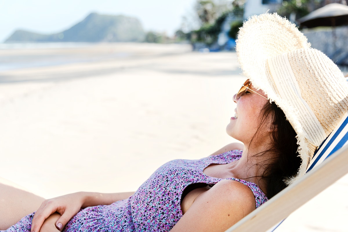 Asian woman relaxing at the beach