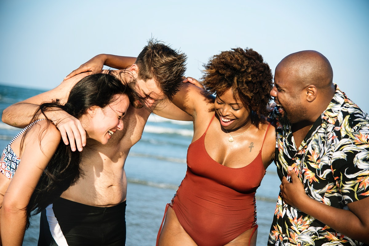 Group of cheerful friends at the beach