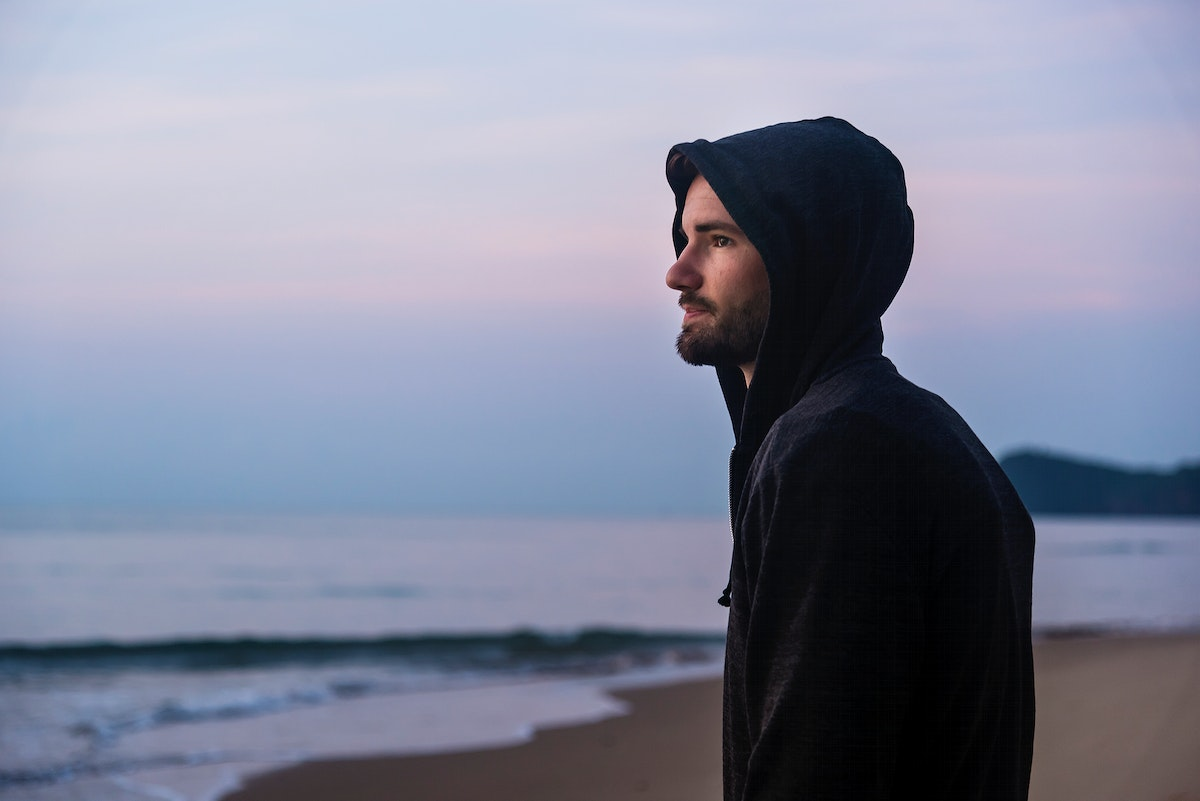 Man walking in solitude at the beach