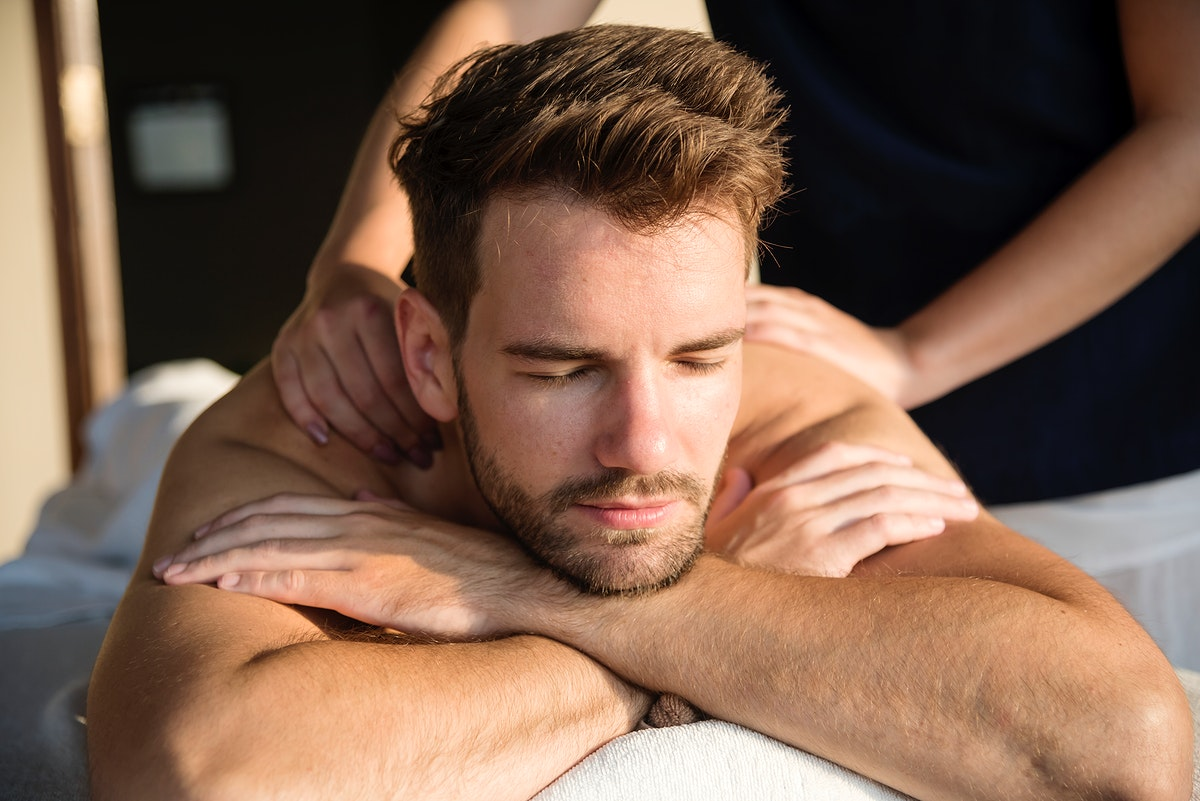 Man getting a message at a spa