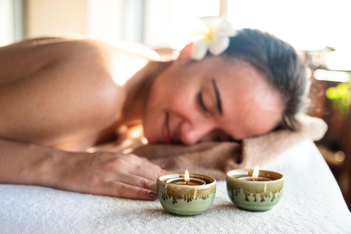 Woman enjoying a relaxing massage at a spa