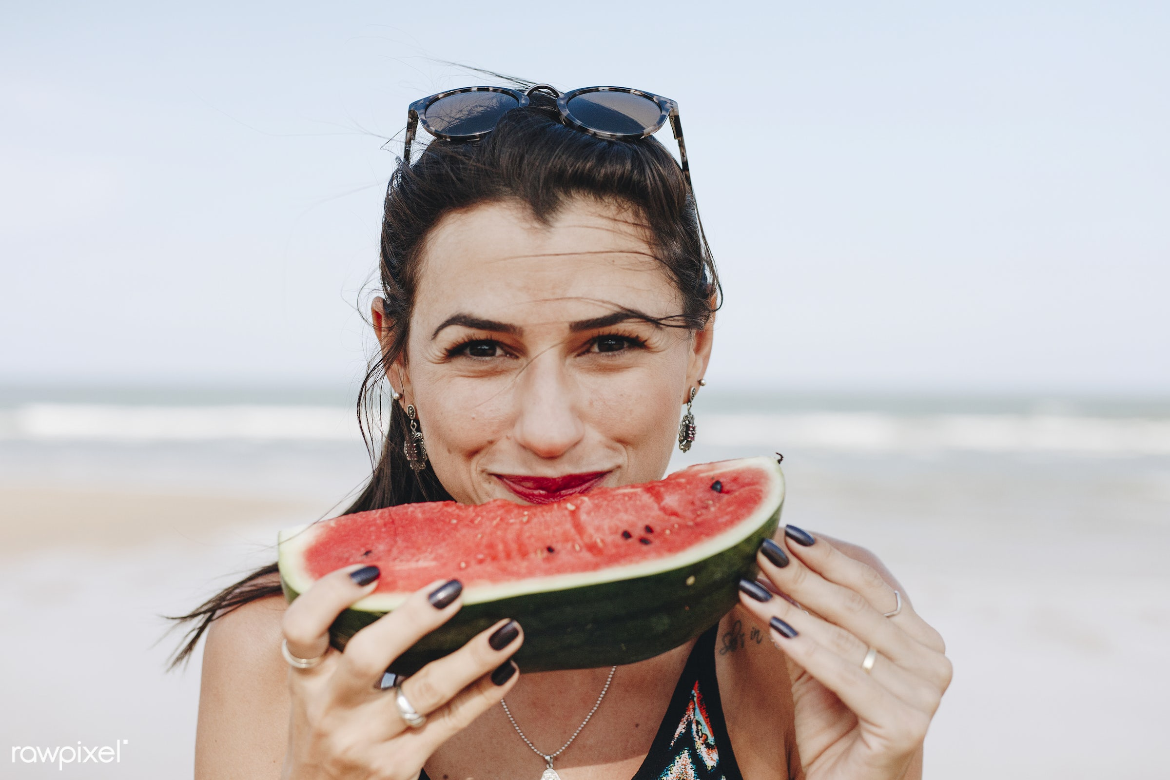 Woman eating watermelon at the beach - beach, cheerful, cut, delicious, eating, european, fresh, freshness, fruit, happiness...