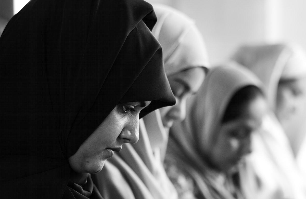 Muslim women praying in Tashahhud posture