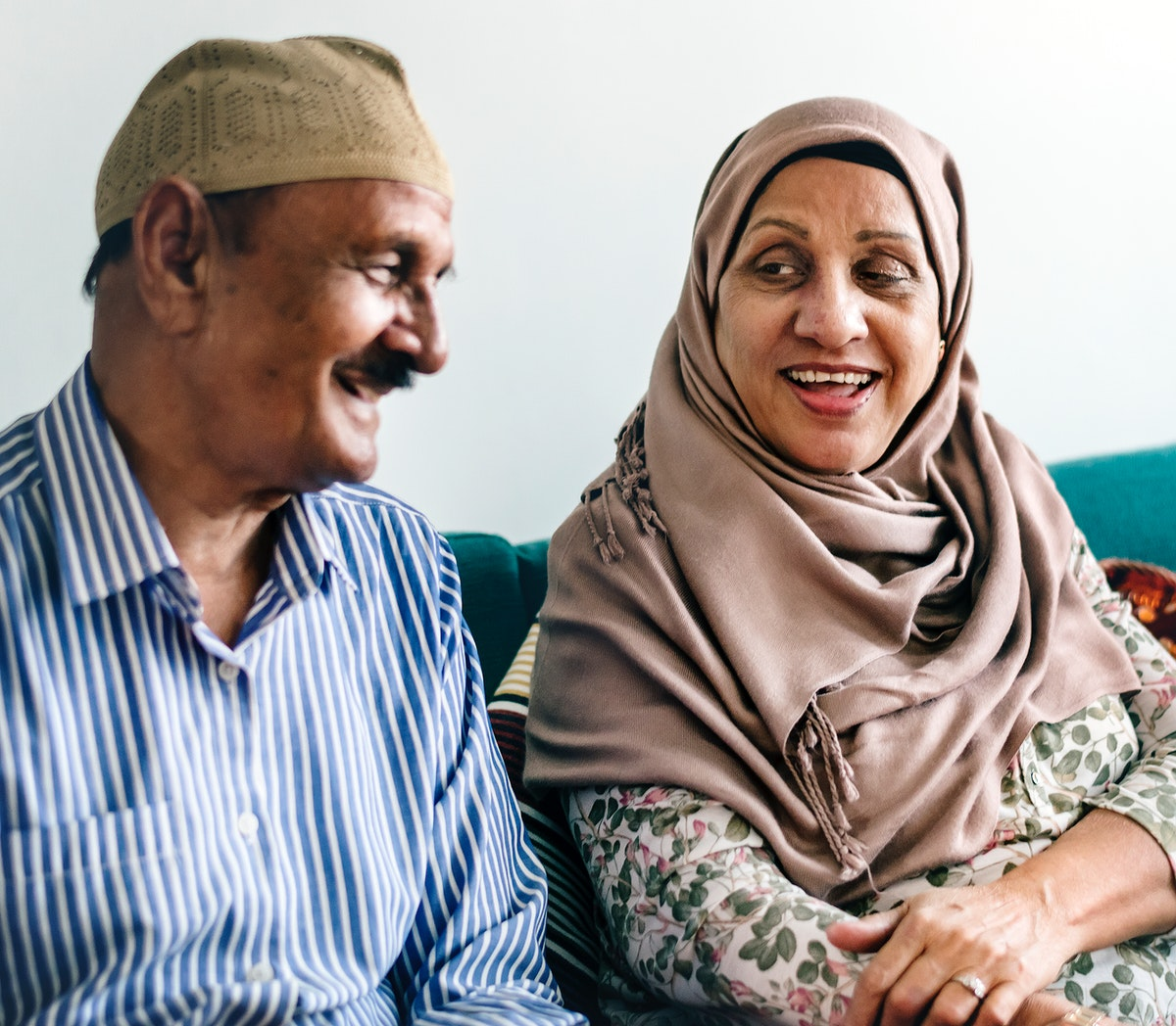 Mature Muslim couple at home