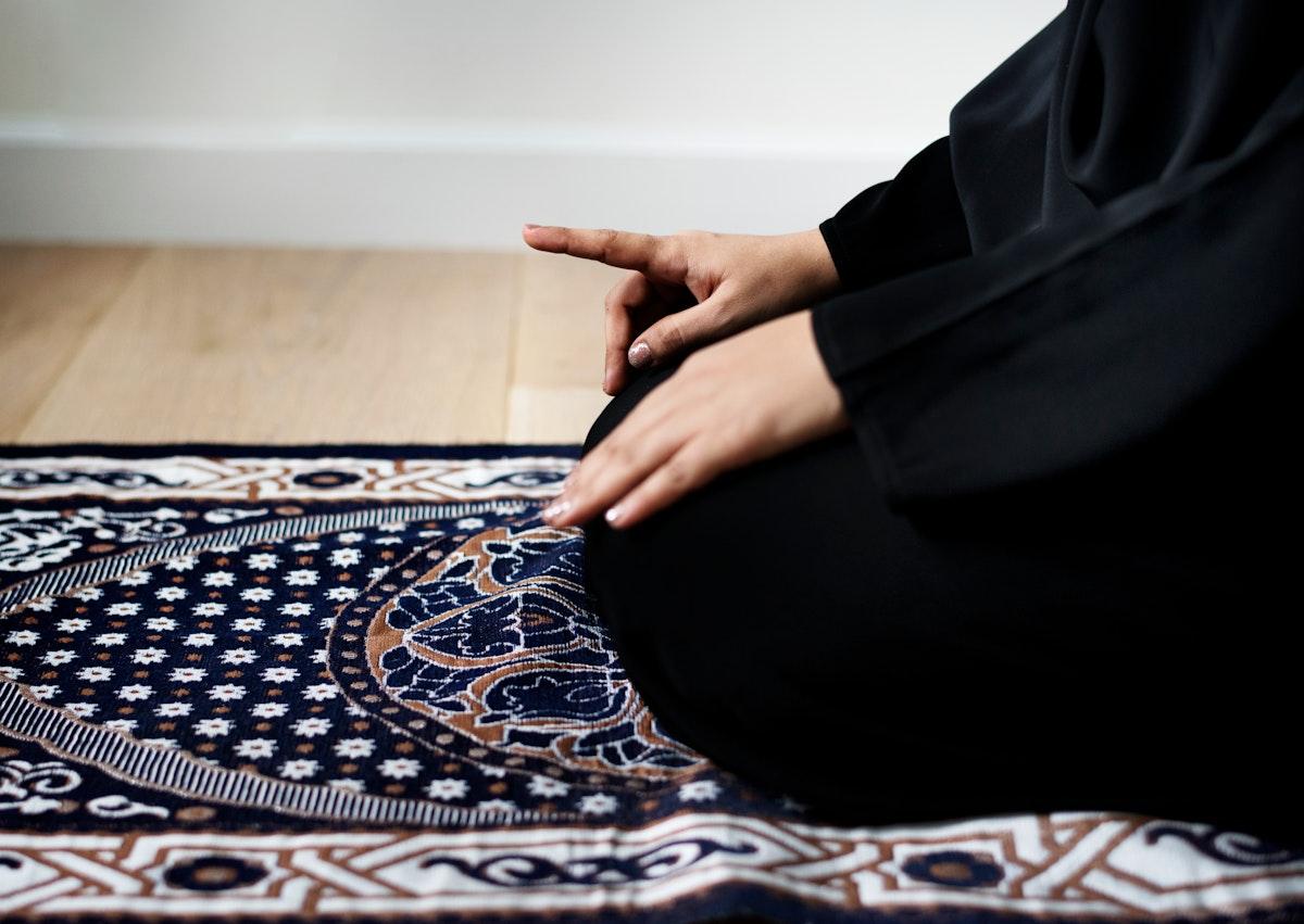 Muslim woman praying in Tashahhud posture