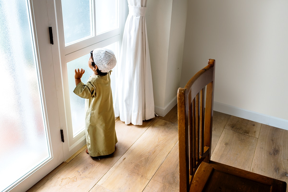 Muslim boy playing at home